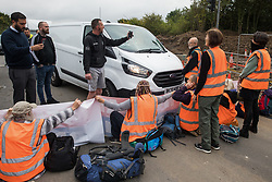 Motorists film Insulate Britain climate activists blocking a slip road from the M25 at Junction 25 as part of a campaign intended to push the UK government to make significant legislative change to start lowering emissions on 15th September 2021 in Enfield, United Kingdom. The activists, who wrote to Prime Minister Boris Johnson on 13th August, are demanding that the government immediately promises both to fully fund and ensure the insulation of all social housing in Britain by 2025 and to produce within four months a legally binding national plan to fully fund and ensure the full low-energy and low-carbon whole-house retrofit, with no externalised costs, of all homes in Britain by 2030 as part of a just transition to full decarbonisation of all parts of society and the economy.