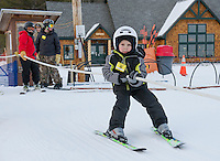 0-14 mph make skiers hold on tight when they grab hold of the rope tow at the Abenaki Ski Area in Wolfeboro.  (Karen Bobotas/for the Laconia Daily Sun)