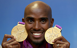 File photo dated 12-08-2012 of Great Britain's Mo Farah with his 2 Olympic gold medals he won in the Men's 10,000, and 5000m
