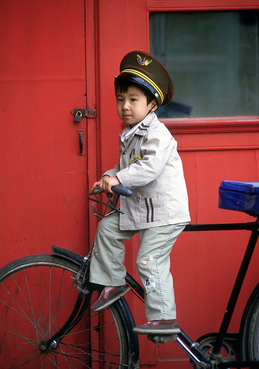 Boy on bike in Bejing,China. Photographed by Terry Fincher
