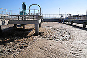 Israel, Haifa Bay Area, Sewerage treatment facility. The treated water is then used for irrigation and to increase the flow n the Kishon river .Secondary sedimentation pools the sludge is removed to the sludge treatment Agitating and airing the water to improve biological breakdown of the sludge