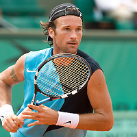 04 June 2007: Carlos Moya of Spain rushes to the ball during the French Tennis Open fourth round match won 7-6(5), 6-2, 7-5 by Carlos Moya over Jonas Bjorkman on day 9 at Roland Garros, in Paris, France.
