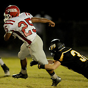 Jacksonville's Jermaine Linton rushes against Topsail's Grant McCoy.