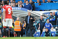 José Mourinho, the Chelsea Manager looks on from the touchline. Barclays Premier league match, Chelsea v Manchester Utd at Stamford Bridge Stadium in London on Saturday 18th April 2015.<br /> pic by John Patrick Fletcher, Andrew Orchard sports photography.