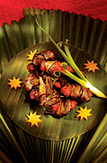 Chicken marinated and cooked in pandanus leaves from Carnets d'Asie