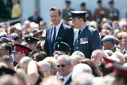 © Licensed to London News Pictures. 11/06/2015. National Memorial Arboretum, Alrewas, Staffordshire, UK. The service to mark the Rededication of the Bastion Memorial. The memorial was begun in Helmand Province in 2006, deconstructed in 2014 and now replicated at the National Memorial Arboretum in Staffordshire. Around two thousand people took part in the service including HRH Prince Harry, the Prime Minister David Cameron and senior members of the Armed Forces. Pictured, Prime Minister DAVID CAMERON arriving. Photo credit : Dave Warren/LNP