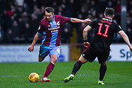 Anthony McMahon of Scunthorpe United (4) plays the ball forward during the EFL Sky Bet League 1 match between Scunthorpe United and Sunderland at Glanford Park, Scunthorpe, England on 19 January 2019.