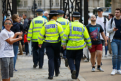 © Licensed to London News Pictures. 03/08/2016. London, UK. Metropolitan police officers leave Horse Guards Parade in Westminster, London after the change of guards on 3 August 2016. More armed police will be seen on patrol in London, Metropolitan Police commissioner Sir Bernard Hogan-Howe and Mayor of London Sadiq Khan announced. Photo credit: Tolga Akmen/LNP