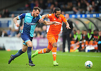 Blackpool's Nathan Delfouneso under pressure from Wycombe Wanderers' Max Muller<br /> <br /> Photographer Kevin Barnes/CameraSport<br /> <br /> The EFL Sky Bet League Two - Wycombe Wanderers v Blackpool - Saturday 11th March 2017 - Adams Park - Wycombe<br /> <br /> World Copyright © 2017 CameraSport. All rights reserved. 43 Linden Ave. Countesthorpe. Leicester. England. LE8 5PG - Tel: +44 (0) 116 277 4147 - admin@camerasport.com - www.camerasport.com