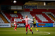 Scott Cuthbert of Stevenage goes to header the ball during the EFL Sky Bet League 2 match between Stevenage and Barrow at the Lamex Stadium, Stevenage, England on 27 March 2021.