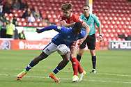 Walsall defender Joe Edwards (2) battles for possession with Oldham Athletic midfielder Temitope Obadeyi (30) 1-1 during the EFL Sky Bet League 1 match between Walsall and Oldham Athletic at the Banks's Stadium, Walsall, England on 12 August 2017. Photo by Alan Franklin.