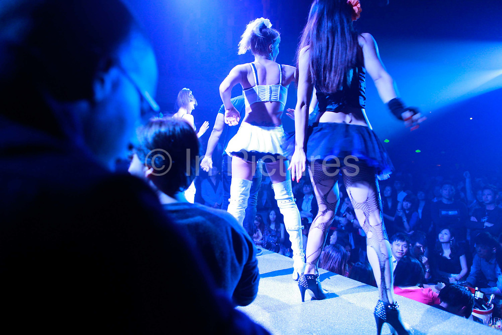 Performers sing and dance on stage at the popular M2 club in Shanghai, China on Oct. 14, 2011.  The city's clubs are popular among affluent youth as well as expatriates.