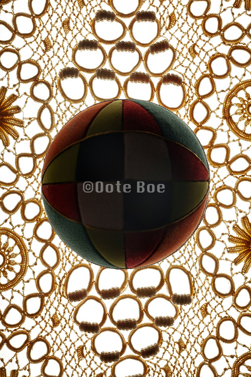 lace fabric with colorful toy ball