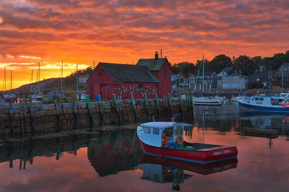 New England photo of the famous red fishing shack Motif #1 in Rockport, Massachusetts on Cape Ann. The photograph captures the local fishing boats with the iconic landmark and a stunningly beautiful sunrise sky. The historic landmark is known throughout New England as Motif #1, so called because it is the most often painted building in America.<br /> <br /> New England photo images of Rockport Motif Number 1 at sunrise are available as museum quality photography prints, canvas prints, acrylic prints, wood prints or metal prints. Prints may be framed and matted to the individual liking and interior design wall art decorating needs: <br /> <br /> https://juergen-roth.pixels.com/featured/rockport-harbor-sunrise-juergen-roth.html<br /> <br /> Good light and happy photo making!<br /> <br /> My best,<br /> <br /> Juergen<br /> Photo Prints & Licensing: http://www.rothgalleries.com<br /> Photo Blog: http://whereintheworldisjuergen.blogspot.com<br /> Instagram: https://www.instagram.com/rothgalleries<br /> Twitter: https://twitter.com/naturefineart<br /> Facebook: https://www.facebook.com