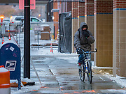 11 NOVEMBERS 2019 - DES MOINES, IOWA: A bicyclist bundled because of single digit temperatures on a sidewalk in downtown Des Moines Monday. Temperatures plunged to 20 degrees below normal for this time of the year in Iowa. About three inches of snow fell in the Des Moines area Sunday night into Monday morning snarling the Monday morning rush hour and delaying central Iowa schools by about two hours.       PHOTO BY JACK KURTZ