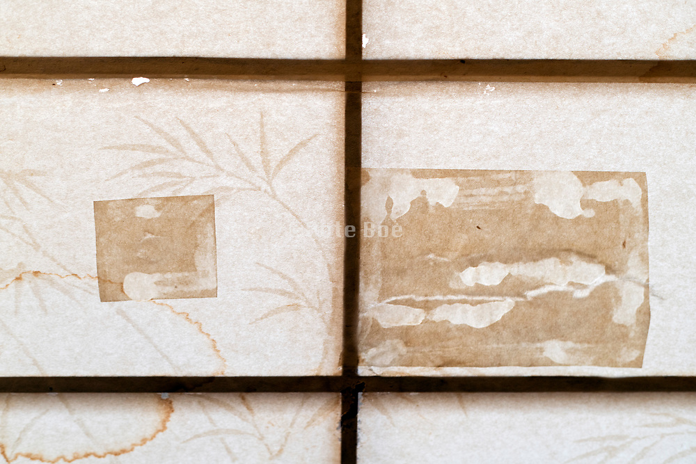 Shoji door close up with grass drowing and repair patches Japan