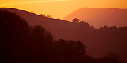 Canyons at sunset in the rolling hills on thecentraal California coast.