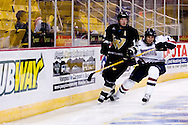 October 13, 2007 - Anchorage, Alaska: Joel Gasper (17) of the Robert Morris Colonials battles with Jeff Caister (14) of the Wayne State Warriors behind the goal as the Colonials take a 4-1 victory over the Wayne State Warriors at the Nye Frontier Classic at the Sullivan Arena.