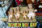 Replicas of the baby Jesus on sale at Our Lady of Guadalupe Church in Mexico City. (Supporting image from the project Hungry Planet: What the World Eats.)