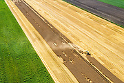 Nederland, Groningen, Gemeente Vlagtwedde, 05-08-2014; Vledderkampen, graanoogst in de veenkolonien. De combine maait het graan en dorst dit direct, het zgn. maaidorsen. N<br /> Grain harvest in a peat landscape, East Netherlands (near German border). The combine reaps the grain and threases it. <br /> luchtfoto (toeslag op standard tarieven);<br /> aerial photo (additional fee required);<br /> copyright foto/photo Siebe Swart