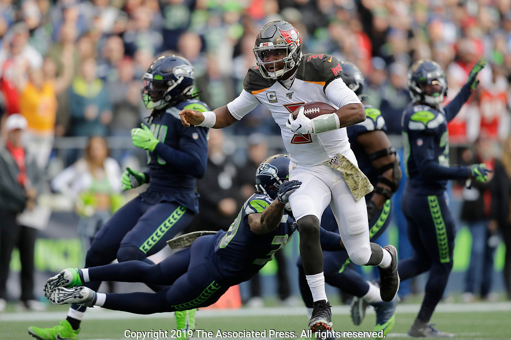 Tampa Bay Buccaneers quarterback Jameis Winston (3) is tackled by Seattle Seahawks strong safety Bradley McDougald as Winston keeps the ball during the second half of an NFL football game, Sunday, Nov. 3, 2019, in Seattle. (AP Photo/John Froschauer)