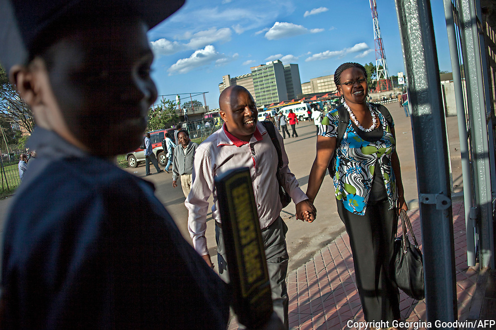 Passengers for the new Nairobi Commuter Railway train enter security and the KSh.400 million revamp of Nairobi Railway Station launched by Kenya's President Mwai Kibaki on Tuesday 13th November 2012 marking the next stage of railway development in the country since the earliest accounts of Nairobi's history dating back to 1899. Passengers pay Sh120 one way for the 18-kilometre journey between the CBD and Soykamau which is takes a comfortable 30 minutes. Before the new service commuters paid KSh.50 for a matatu bus along the Kitengela-Mlolongo route which is often dangerous and can take over 2 hours depending on traffic.