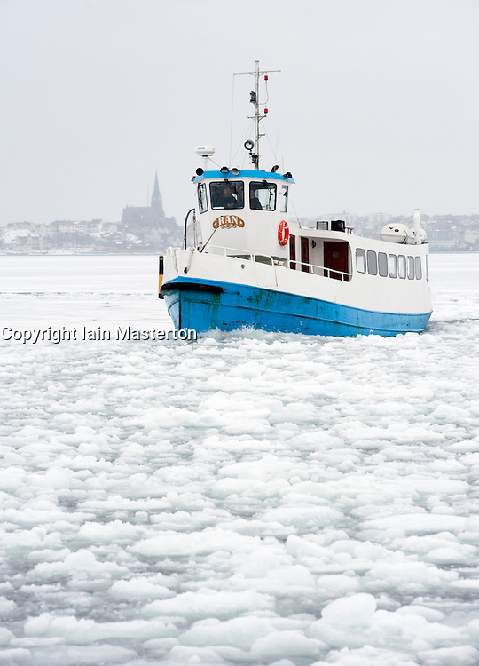Passenger ferry sailing through sea ice to  village of Fiskebackskil during cold winter 2010 on Bohuslan coast in Vastra Gotaland Sweden