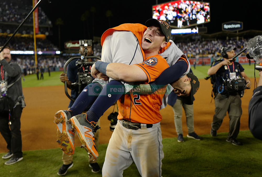 November 1, 2017 - Los Angeles, California, U.S. - Houston Astros' Alex Bregman (2) hoists up teammate Jose Altuve as they celebrates as they defeat the Los Angeles Dodgers 5-1 in game seven of a World Series baseball game at Dodger Stadium on Nov. 1, 2017 in Los Angeles. (Photo by Keith Birmingham, Pasadena Star-News/SCNG) (Credit Image: © San Gabriel Valley Tribune via ZUMA Wire)
