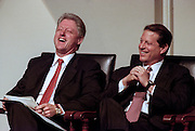 President Bill Clinton shares a laugh with Vice-President Al Gore during a discussion on the computer glitch known as the Year 2000 problem or by it's acronym 'Y2K' at the National Academy of Science July 14, 1998 in Washington, DC. The glitch involves the failure of computer software to recognize the year 2000 and can potentially cause massive problems in government and industry.