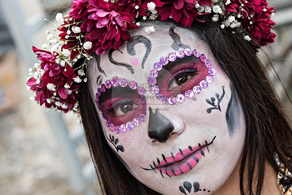 A young Mexican woman dressed in La Calavera Catrina costume for the Day of the Dead or Día de Muertos festival October 31, 2017 in Patzcuaro, Michoacan, Mexico. The festival has been celebrated since the Aztec empire celebrates ancestors and deceased loved ones.