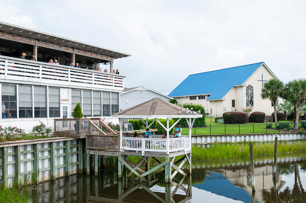 Outdoor seating - and the best view in the house - at Jinks Creek Waterfront Grille in Ocean Isle Beach, North Carolina on Friday, August 6, 2021. Copyright 2021 Jason Barnette