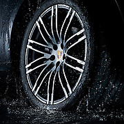 Porsche wheel going through water creating a splash Ray Massey is an established, award winning, UK professional  photographer, shooting creative advertising and editorial images from his stunning studio in a converted church in Camden Town, London NW1. Ray Massey specialises in drinks and liquids, still life and hands, product, gymnastics, special effects (sfx) and location photography. He is particularly known for dynamic high speed action shots of pours, bubbles, splashes and explosions in beers, champagnes, sodas, cocktails and beverages of all descriptions, as well as perfumes, paint, ink, water – even ice! Ray Massey works throughout the world with advertising agencies, designers, design groups, PR companies and directly with clients. He regularly manages the entire creative process, including post-production composition, manipulation and retouching, working with his team of retouchers to produce final images ready for publication.