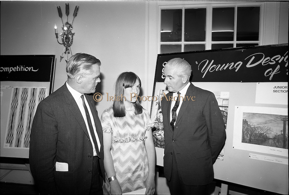 """28/06/1967<br /> 06/28/1967<br /> 28 June 1967<br /> Presentation of prizes at Navan Carpets """"Young Designer of the Year"""" reception in the Royal Hibernian Hotel, Dublin. Image shows (l-r): Mr. Allan Mallinson, Managing Director, Navan Carpets Ltd.; Miss Catherine Martin, Technical School Navan, who won joint 1st and 2nd in the Junior Section and Mr James White, Director, National Gallery of Ireland."""