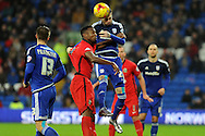 Cardiff City's Scott Malone wins a header against Blackburn Rover's Hope Akpan. Skybet football league championship match, Cardiff city v Blackburn Rovers at the Cardiff city stadium in Cardiff, South Wales on Saturday 2nd Jan 2016.<br /> pic by Carl Robertson, Andrew Orchard sports photography.