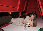 JULIA FILIPOVSCAVA, RELAXING INSIDE INSTALLATION DESIGNED BY ALESSANDRO BAVA,Serpentine Gallery and Harrods host the Future Contempories Party 2016. Serpentine Sackler Gallery. London. 20 February 2016