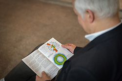 1 December 2019, Madrid, Spain: A man reads a publication on climate change, as representatives of various faiths gather in the Iglesia de Jesús (Church of Christ) of the Iglesia Evangélica Española (Evangelical Church of Spain) for an interfaith dialogue and prayer service on the eve of the United Nations climate conference (COP25) in Madrid, Spain.