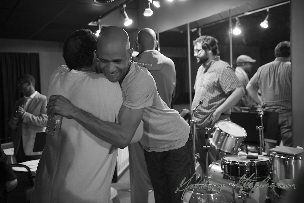 Drummer/bandleader Marcus Finnie receives a hug from Charles Dungey, Jr. after an unforgettable performance at Nine48Jazz, the now-closed jazz club in Nashville, TN run by Charles' sister Kandes Dungey.