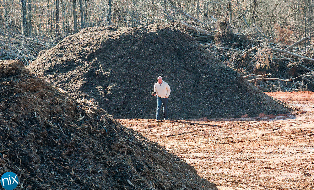 Ron Gilkerson, from Agromatters, shows off fresh compost soil at his a new 15-acre public/private compost facility at Cabarrus County's Construction and Demolition Landfill