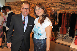 JONATHAN NEWHOUSE and ALEXANDRA SHULMAN at a party to celebrate the launch of the Vogue Fashion's Night Out held at Mulberry, Bond Street, London on 6th September 2012.