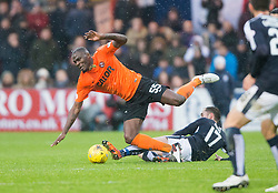 Dundee United's Guy Demel tackled by Dundee's Nick Ross. <br /> Dundee 2 v 1  Dundee United, SPFL Ladbrokes Premiership game played 2/1/2016 at Dens Park.