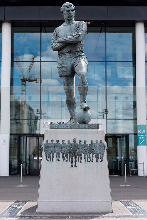 © Licensed to London News Pictures. 30/07/2016. Bronze statue of England footballer BOBBY MOORE outside Wembley Stadium on the 50th anniversary of England beating Germany in the World Cup finals on 30th July 1966.  London, UK. Photo credit: Ray Tang/LNP