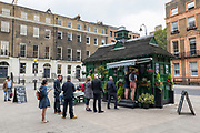 People queuing at a Cabmens Shelter cafe at Russell Square on the 16th September 2019 in London in the United Kingdom.