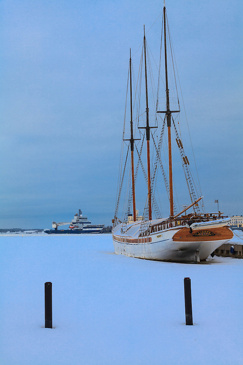 A schooner Linden and ice breaker Nordica on backround in Helsinki, Finland. A former cargo ship serves nowadays as a charter ship.