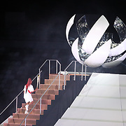 TOKYO, JAPAN - JULY 23: Naomi Osaka of Japan before llighting the olympic frame at the Opening Ceremony for the Tokyo 2020 Summer Olympic Games at the Olympic Stadium on July 23, 2021 in Tokyo, Japan. (Photo by Tim Clayton/Corbis via Getty Images)
