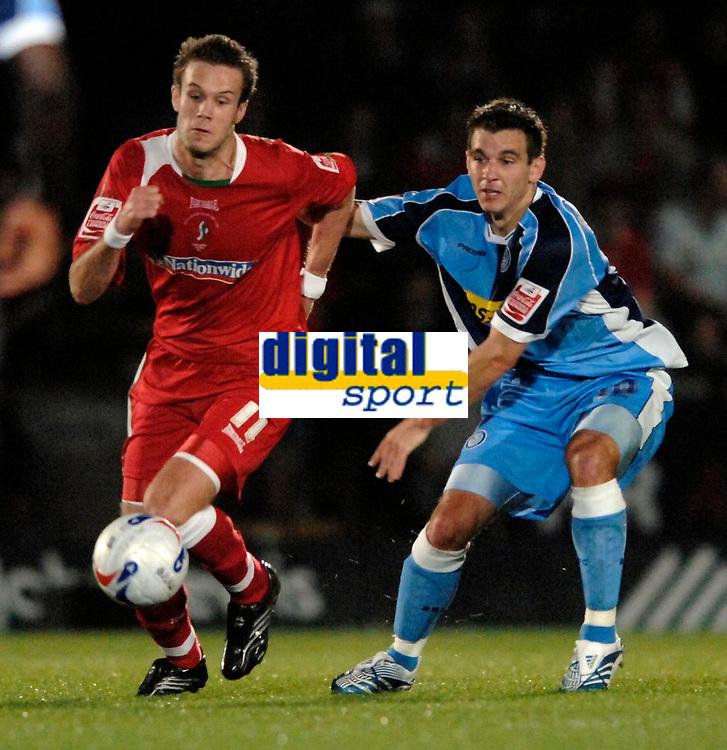 Photo: Richard Lane.<br />Wycombe Wanderers v Swindon Town. Coca Cola League 2. 26/09/2006. <br />Swindon's Andy Monkhouse breaks past Wycombe's Matt Bloomfield.