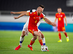 HELSINKI, FINLAND - Thursday, September 3, 2020: Wales' Jonathan Williams gets away from Finland's captain Tim Sparv during the UEFA Nations League Group Stage League B Group 4 match between Finland and Wales at the Helsingin Olympiastadion. (Pic by Jussi Eskola/Propaganda)