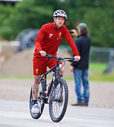 ROTTACH-EGERN, GERMANY - Friday, July 28, 2017: Liverpool's Alberto Moreno cycles to a training session at FC Rottach-Egern on day three of the preseason training camp in Germany. (Pic by David Rawcliffe/Propaganda)