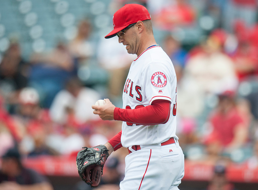 Angels' starting pitcher David Huff looks at the ball during a rough outing against the Cleveland Indians Sunday at Angel Stadium. Huff gave up five runs (two earned) in one and 2/3 innings.<br /> <br /> ///ADDITIONAL INFO:   <br /> <br /> angels.0612.kjs  ---  Photo by KEVIN SULLIVAN / Orange County Register  -- 6/12/16<br /> <br /> The Los Angeles Angels take on the Cleveland Indians Sunday at Angel Stadium.