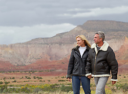 couple walking together in Abiquiu, New Mexico