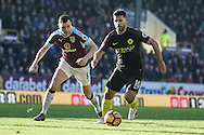 Burnley midfielder Dean Marney (8) and Manchester City striker Sergio Aguero battle during the Premier League match between Burnley and Manchester City at Turf Moor, Burnley, England on 26 November 2016. Photo by Pete Burns.